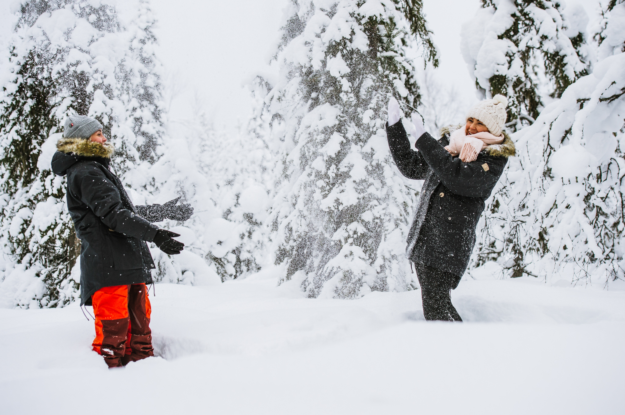 people throw snow in the air
