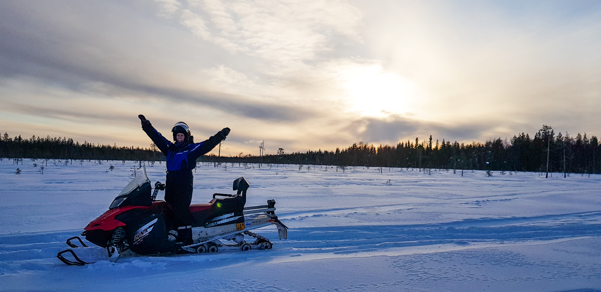 woman on snowmobile and landscape