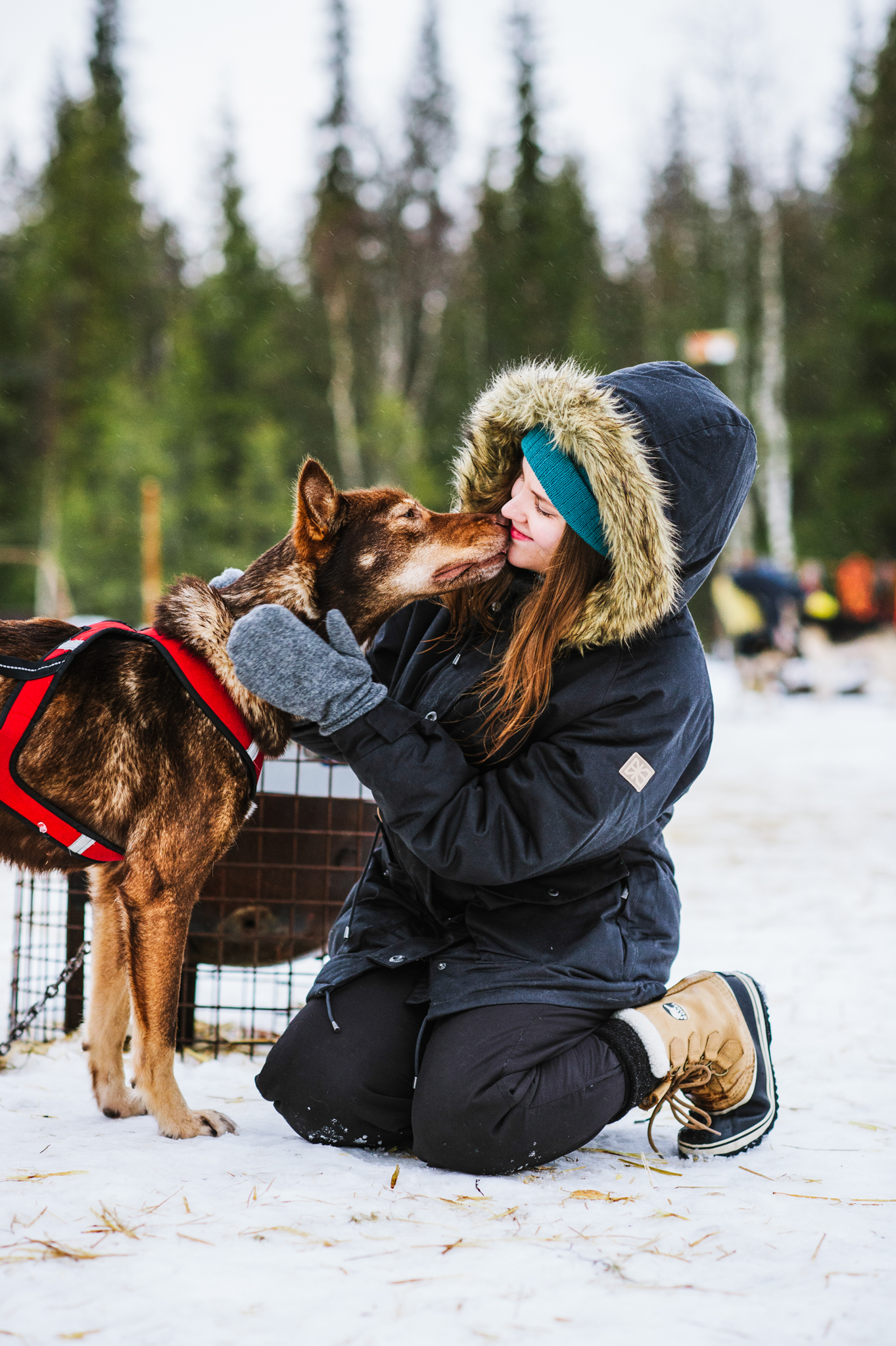 woman cuddling husky