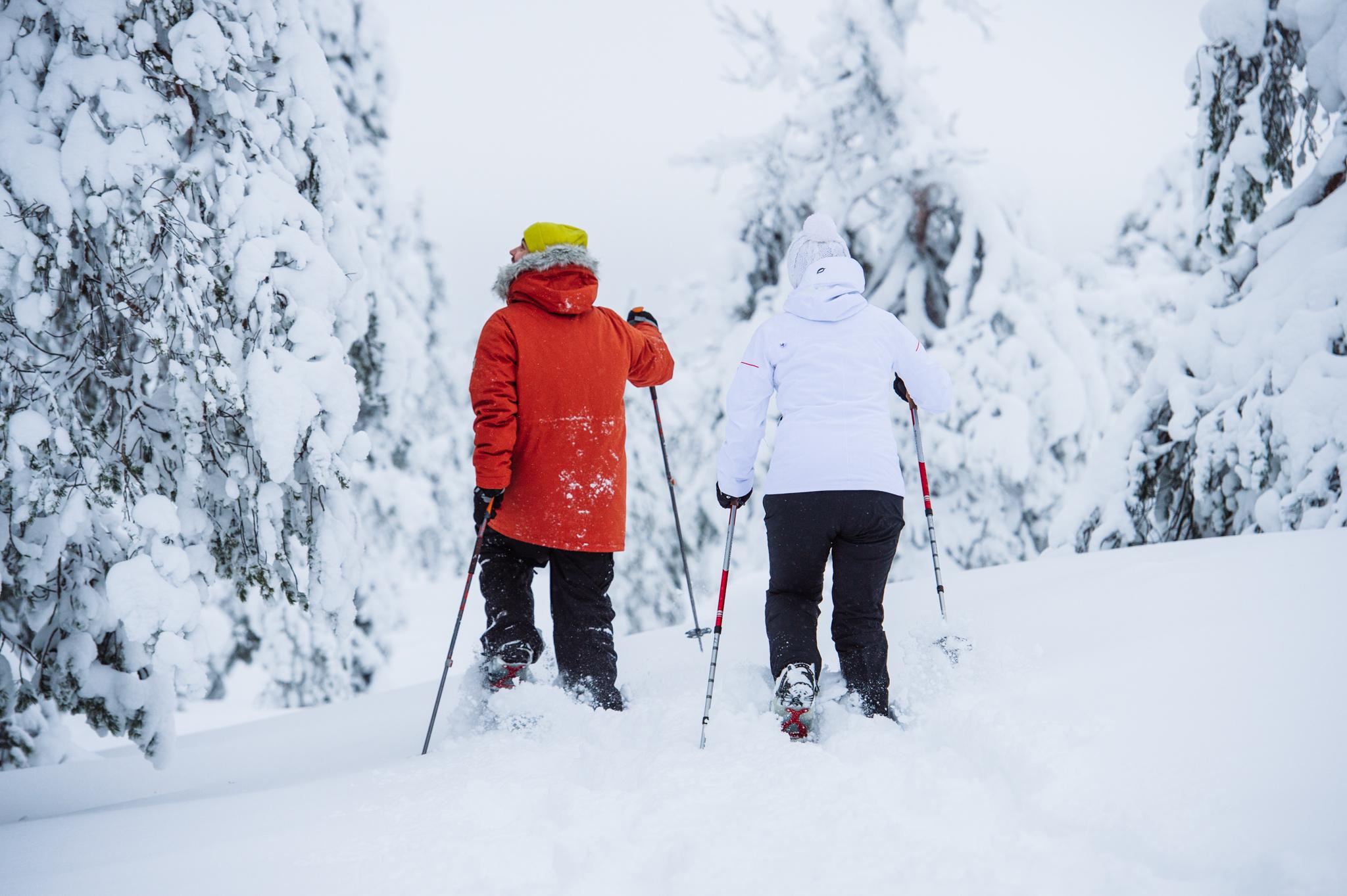 two people on snowshoe trip in deep snow