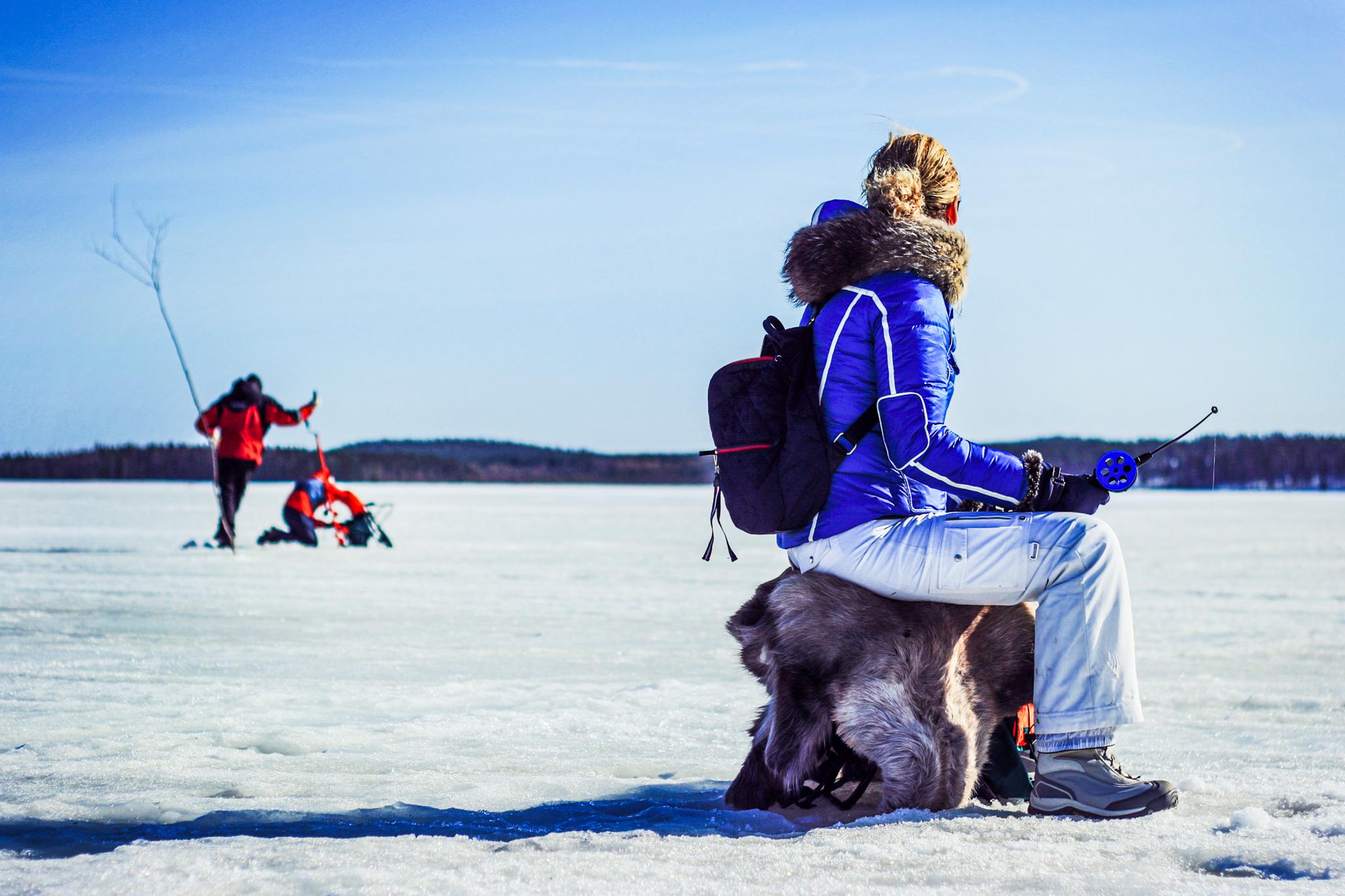 ice fishing on frozen lake
