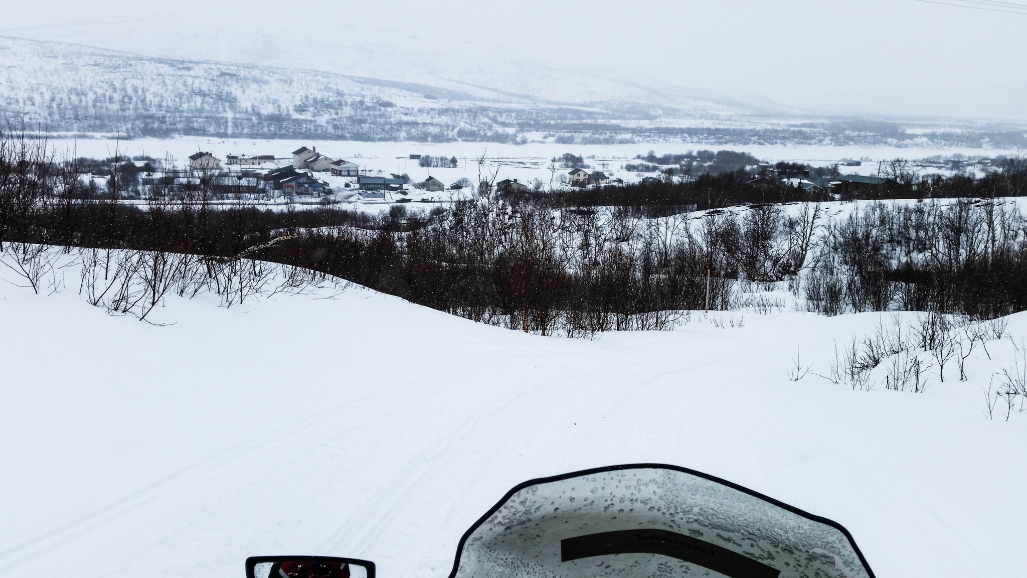 view of small village and snowy landscape