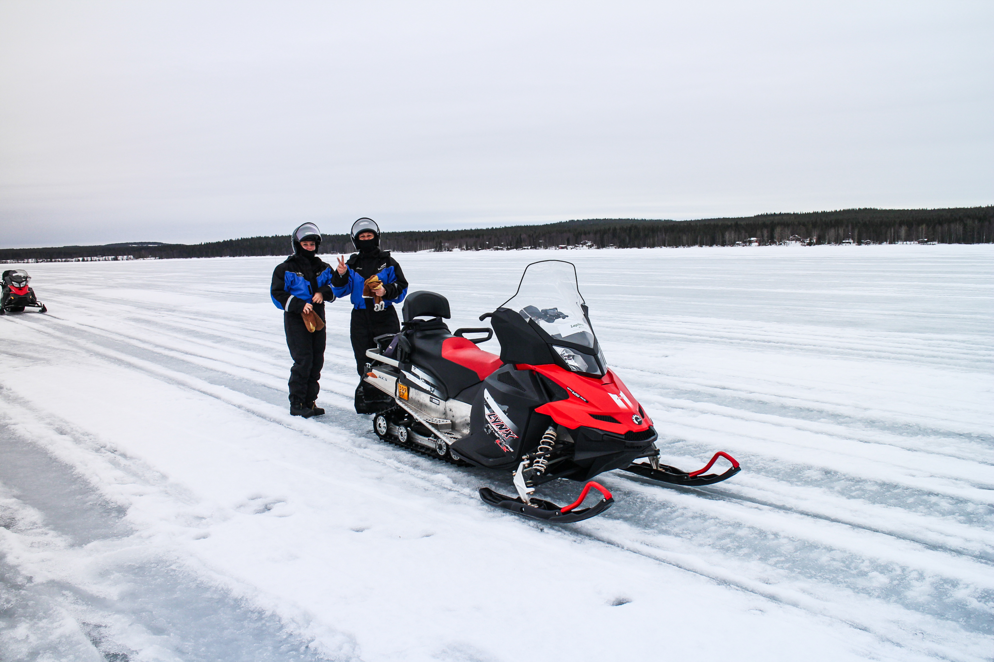 Two people with Snowmobile in Landscape