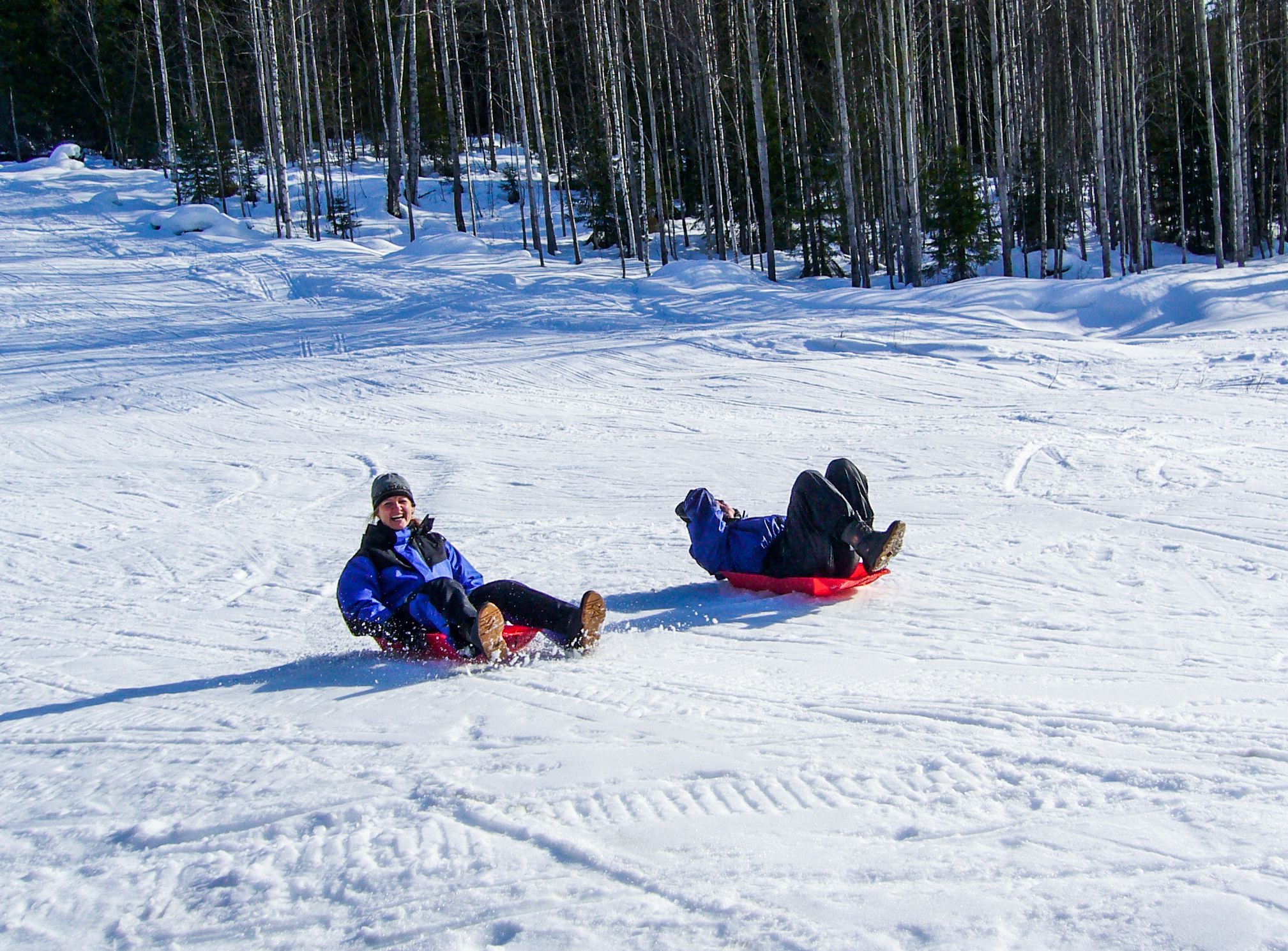 two people sledding